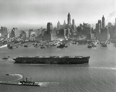 USS Lafayette (formerly SS Normandie) is towed down the Hudson, 1945.