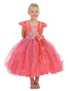 Your little angel will shine bright like a diamond in this fabulous glitter and tulle dress. The spaghetti strap bodice is adorned with wonderful glitzy accents and has a bow accented by a rhinestone brooch. The classic style tulle skirt is also adorned with glitter that little girls love. The dress is fully lined for complete coverage to ensure that your princess stays comfortable and comes with a matching bolero.