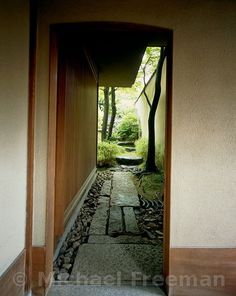 A garden in Kyoto design by Atsushi Akenuji for  the painter Akira Kaho. The house extends over two former properties, at differnt levels, and he wanted to keep his studio separete from the living areas. Because the space available for the garden is on a short steep slope, Akenuki created two gardens, one the walk to the studio and the other a framed view from the living room. Door leading off the porch.