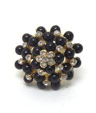 Black flower ring  Buy it here:http://www.sassnfrass.net/#Lorissaleigh