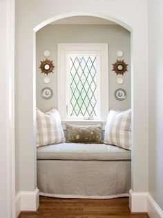 Cozy Reading Nook.... I wonder if you can take out a closet, add a window to do this reading nook... need to find a diy on this. Would be awesome!