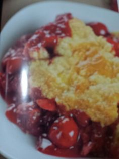 """Cherry Cheesecake Dump Cake From Cathy Mitchell """"Quick and Easy Dump Cakes and more"""" 1 can (21 oz ) cherry pie filling 1 can ( 14 oz )-tart cherries in water, drained 4 oz cream cheese, cut into small pieces 1/2 cup (1 stick) butter, cut into thin slices 1. Preheat oven to 350F. Spray 13 x 9 baking pan with nonstick cooking spray 2. Spread cherry pie filling and cherries in prepared pan. Scatter cream cheese pieces over cherries. Top,with cake mix, spreading evenly. Top with butter in single layer, covering cake mix as much as possible. 3. Bake 45 to 50 minutes until toothpick inserted into center of cake comes out clean. Cool at least 15 minutes before serving. Makes 12 to 16 servings"""