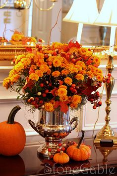 beautiful fall arrangement using a champagne bucket - can do it with pines for Christmas too!