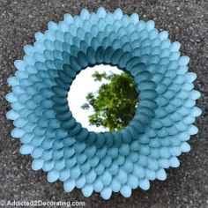 Learn to create this chrysanthemum mirror using cheap plastic spoons.