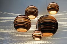 the now ubiquitous greypants pendant lamps. cardboard is sexy....omg i want so bad! Look at those cast shadows!!!