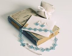 "Handmade tatted jewelry set: necklace and earrings in pastel blue - a sweet ""something blue"" accessory for your wedding."