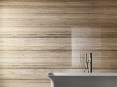 Shown here is the Stratos shade from the collection. The tile gives a great finish to the wall. #HIT #Design #Tile