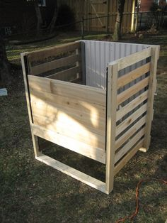Here's an instructable for creating your own wood framed, bottom access compost bin. It's worked great for our family for going on six years now, and it is fairly low maintenance.