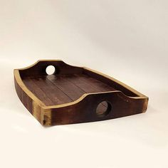 This red wine barrel Serving Tray is made from hand selected recycled Napa valley red wine barrels and re-purposed in to this beautiful serving tray sure to be the center of attention. The curved sides are made from the barrel staves and the the bottom is made from the barrel head with
