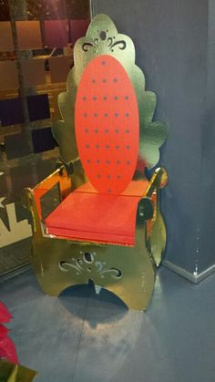 Cardboard throne, at the back to a chair for mama to be, maybe silver and blue