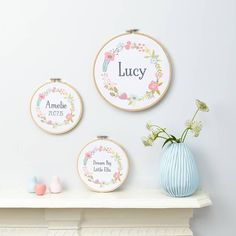A sweet and original personalised print framed in an embroidery hoop.The hoop can be personalised to include any word, name or short sentence of your choice. Available in 2 sizes - small or large.There's nothing quite as special as a made to order gift. Each of these hoops is printed with your child's name, surrounded by a colourful floral wreath. It's a unique gift for a new baby or just for your little love's nursery or playroom. They look fantastic hung on a wall, a door or si...