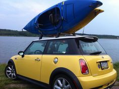 Two kayaks on a MINI. #RaisetheRoofRack #camping #adventure