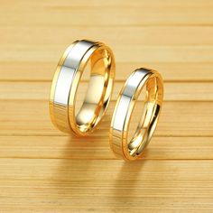 Couple rings of this style are a daring yet dazzling choice she or he won't be able to resist. Delicious in stainless steel, this exceptional gold piece captivates with a silver center with the rest of the ring being high polished . Mesmerizing with a brilliant buffed luster, this ring is more than she or he can imagine. Tungsten Rings, Titanium Rings, Couple Ring Design, Men Rings, Couple Rings, Modern Fashion, Luster, Fashion Rings, Ring Designs