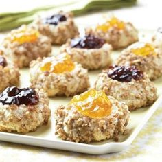Thumbprint Cookies Recipes | These cookies have a bit of crunch from the finely chopped pecans, sweetness from the almond extract, and richness from the butter. | SouthernLiving.com Find more at http://porkrecipe.org/posts/Thumbprint-Cookies-Recipes-These-cookies-have-a-45469