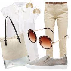 Outfit basic per passeggiate comode senza fretta: pantalone tinta classica coloniale e camicetta romantica con fiocco a ingentilire lo stile, immancabile l'occhiale tondo da sole, la borsa capiente e le scarpe basse.