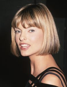 Linda Evangelista in a chin length bob with bangs.