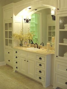 Great bathroom cabinets and storage.  Love the seeded glass on doors.