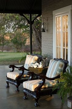 Lovely.   Love these chairs for the front porch. How cool to find a couple old chairs, paint them and put cushions on them.