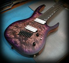 Kiesel Guitars Carvin Guitars  DCM8 - Purple caliburst over hand selected burl maple top with quilt pattern and custom thin black burst edges, Kiesel Lithium pick ups and Hipsgot Bridge