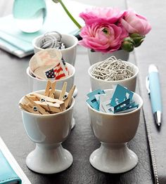 By the Half Dozen  A collection of egg cups lined up in rows makes an attractive organizing tool on a desk. Fill the cups with small desk needs, such as paper clips and stamps or everyday, pick-me-up flowers or candy.