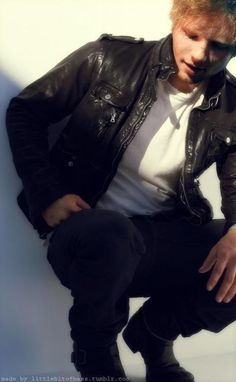 Ed Sheeran in Caption with his Black Leather Jacket. I think this is love, or a severe case of lust.