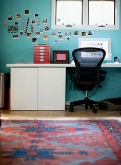 I love turquoise with an older Persian-style rug. It mixes modern and traditional gracefully.