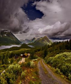 norge.  landscape of mountains and water and tracks