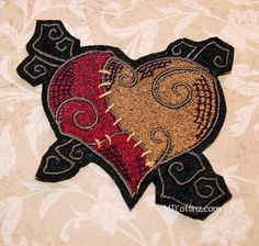 This patchwork Heart was once broken, but it has been stitched back together Its made with brown and deep red (burgundy) thread.    Size: Small: 3.22w