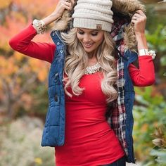 Plaid Lined Puffer Vest with Faux Fur Trim Obsessed with this vest! Navy puffer vest with plaid lining and removable faux fur trim on hood. Zips down, buttons and has toggle closure. Stay warm and cozy in this amazing vest! S - M - L available. Also available in red. No trades. Price is firm. Boutique Jackets & Coats Vests