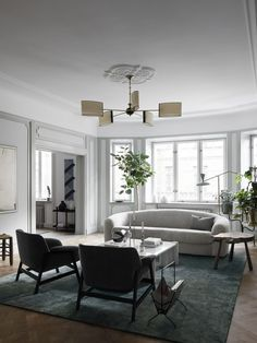 Apartment S. Lunel lamp, Frattini chairs, Jumbo table by Gae Aulenti, Albert Johansson and Carl Magnus artwork. Home Living Room, Living Spaces, Classic Building, Interior Design Work, Swedish Design, Swedish Style, French Furniture, Elle Decor, Design Firms