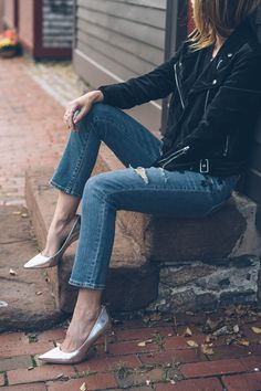 e95a379ce4f Silver metallic pumps and velvet moto jacket with jeans for holiday style