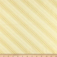 All Wrapped Up Metallic Diagonal Stripe Cream/Gold from @fabricdotcom  Designed by Skipping Stones Studio for Clothworks, this cotton print fabric is perfect for quilting, apparel and home decor accents. Colors include cream. Features gold metallic accents throughout.