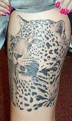 http://www.coolanimaltattoos.com/wp-content/uploads/2010/10/leopard-tattoo-art.jpg
