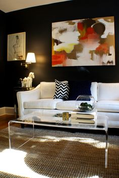 If only I had the nerve!  Those black walls, the color palette and the lucite table are awesome.