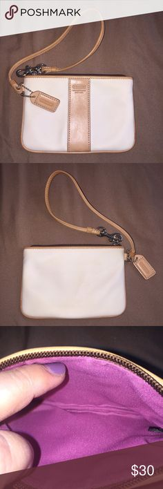 Authentic Coach Wristlet Authentic Coach Wristlet (white & tan)  Details: 4 in H x 5 3/4 in W. Nylon with leather trim, top zip closure.  Has pink fabric lining (inside) & strap with clip to use as wrist strap or attach to inside of a bag. Dust bag included.  Excellent Used Condition Smoke/pet free home Coach Bags Clutches & Wristlets