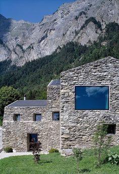 A rustic stone home in Chamoson, Switzerland | Redesigned by Savioz Fabrizzi Architectes.