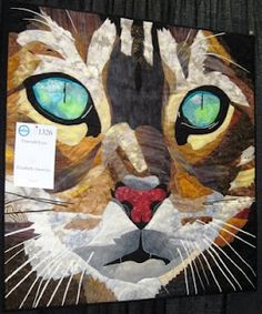 """Emerald Eyes"" by Elizabeth Janowitz, photo by Quilter Beth. Fused appliqué, thread painting, and fabric painting."