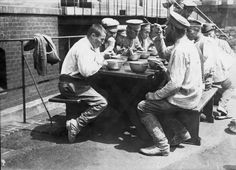 WWI, 1917, Berlin: Russians POWs having lunch in a poisonous gas factory where they worked. Gallica France.