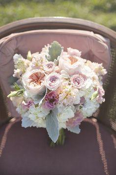 beautiful pastel colored bridal bouquet #pastelflorals #bouquet #weddingchicks http://www.weddingchicks.com/2014/01/27/pastel-sheep-wedding-inspiration