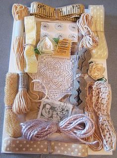 """Collection of yellow and peach ribbons, trims, threads, and notions - I really like her way of displaying things with like colors - her blog is full of creativity in many areas, not just """"DIY"""" and crafts - definitely worth checking out"""