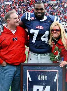Leigh Anne and Sean Tuohy with their son, Michael Oher. A true inspiration!! And HOTTY TODDY!