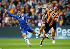 Hazard reacts to a challenge from Hull midfielder David Meyler during the first half of the Premier League clash