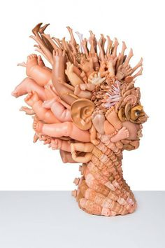 Shocking heads made of dismembered doll parts