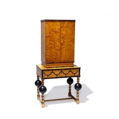 Cabinet on stand in Baltic flame birch, macassar ebony and ebonized wood attributed to Axel Einar Hjorth (1888-1959), Sweden, 1920s. This exquisite piece represents an interesting variant on the Modern Classicism style popular in Sweden in the 1920s, looking back to 17th century northern baroque prototypes.