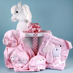 Rockabye baby personalized rocking horse with plush toy and find this pin and more on baby clothing bibs baby girls poodle layette gifts set with unique rocking horse negle Image collections