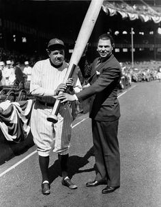 Boxing great Jack Dempsey presents New York Yankees slugger Babe Ruth with a king-sized bat before a game between the Yankees and Red Sox at New York's Yankee Stadium, April 13, 1933. (AP Photo)