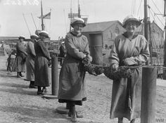 © IWM (Q 19642). IWM caption 'Ratings of WRNS mine net workers wiring together glass floats' in collection WOMEN'S ROYAL NAVAL SERVICE HOME FRONT 1917-1918