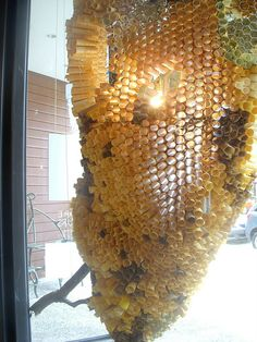 Anthropologie Window display. Paper Beehive Chandelier