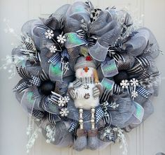 Check out this item in my Etsy shop https://www.etsy.com/listing/208486099/elegant-snowman-wreath-with-silver-deco