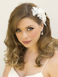 This romantic vintage inspired bridal hair clip features lace flowers and leaves accented with authentic rhinestones.  Available in white or ivory.